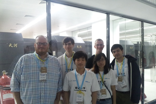 Team in front of Tianhe-2, the worlds fastest supercomputer at the time