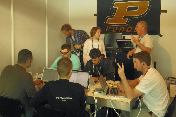 Purdue-Colorado team working at the booth