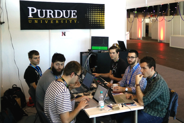 Purdue-Northeastern team working at the booth